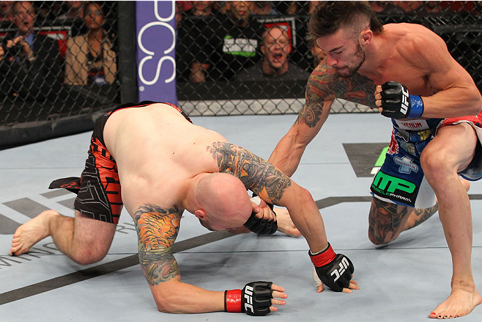 INDIANAPOLIS, IN - AUGUST 28:  (R-L) Brandon Thatch punches Justin Edwards in their welterweight fight during the UFC on FOX Sports 1 event at Bankers Life Fieldhouse on August 28, 2013 in Indianapolis, Indiana. (Photo by Ed Mulholland/Zuffa LLC/Zuffa LLC