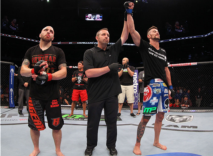 INDIANAPOLIS, IN - AUGUST 28:  Brandon Thatch (R) reacts after his knockout victory over Justin Edwards (L) in their welterweight fight during the UFC on FOX Sports 1 event at Bankers Life Fieldhouse on August 28, 2013 in Indianapolis, Indiana. (Photo by