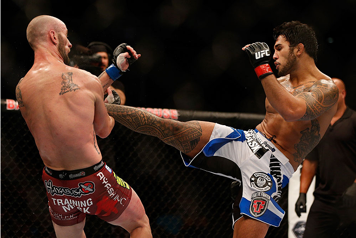 INDIANAPOLIS, IN - AUGUST 28:  (R-L) Brad Tavares kicks Bubba McDaniel in their middleweight fight during the UFC on FOX Sports 1 event at Bankers Life Fieldhouse on August 28, 2013 in Indianapolis, Indiana. (Photo by Josh Hedges/Zuffa LLC/Zuffa LLC via G