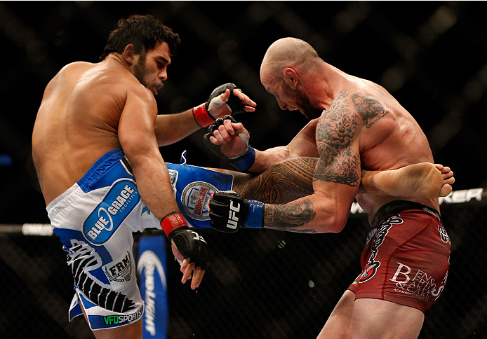 INDIANAPOLIS, IN - AUGUST 28:  (L-R) Brad Tavares kicks Bubba McDaniel in their middleweight fight during the UFC on FOX Sports 1 event at Bankers Life Fieldhouse on August 28, 2013 in Indianapolis, Indiana. (Photo by Josh Hedges/Zuffa LLC/Zuffa LLC via G