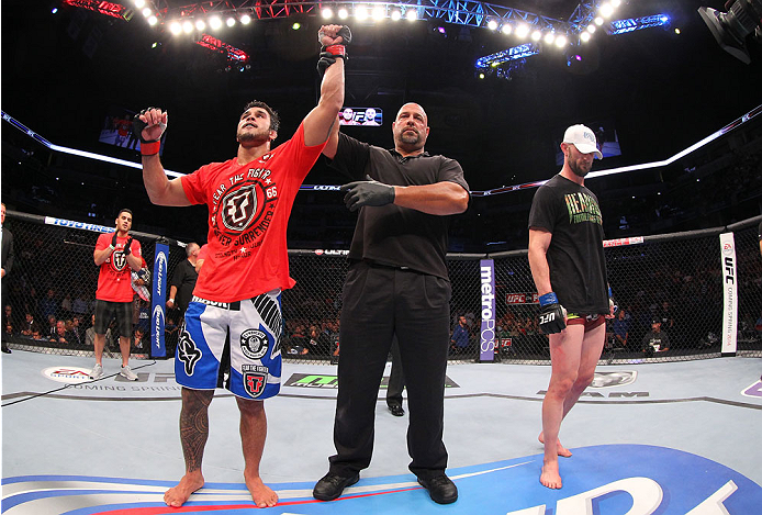 INDIANAPOLIS, IN - AUGUST 28:  Brad Tavares (L) reacts after his decision victory over Bubba McDaniel in their middleweight fight during the UFC on FOX Sports 1 event at Bankers Life Fieldhouse on August 28, 2013 in Indianapolis, Indiana. (Photo by Ed Mul