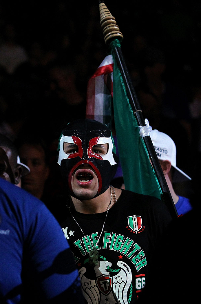 INDIANAPOLIS, IN - AUGUST 28:  Erik Perez enters the arena before his bantamweight fight against Takeya Mizugaki during the UFC on FOX Sports 1 event at Bankers Life Fieldhouse on August 28, 2013 in Indianapolis, Indiana. (Photo by Ed Mulholland/Zuffa LLC