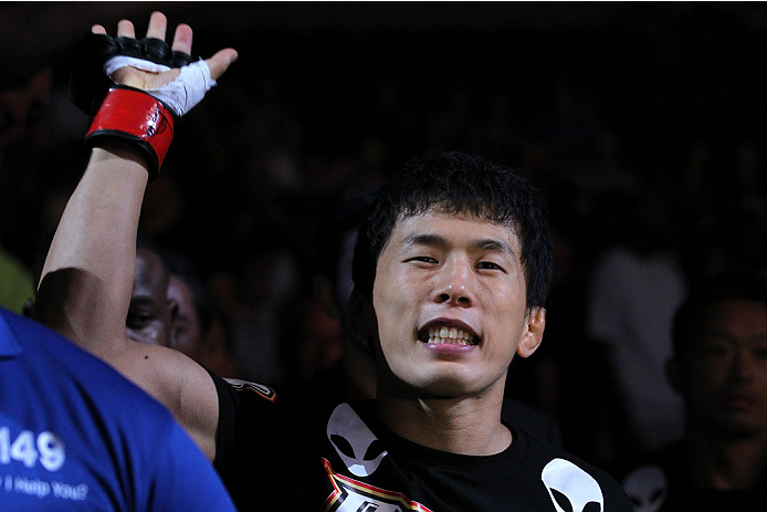INDIANAPOLIS, IN - AUGUST 28:  Takeya Mizugaki enters the arena before his bantamweight fight against Erik Perez during the UFC on FOX Sports 1 event at Bankers Life Fieldhouse on August 28, 2013 in Indianapolis, Indiana. (Photo by Ed Mulholland/Zuffa LLC