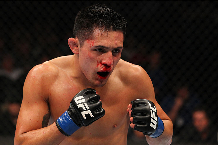 INDIANAPOLIS, IN - AUGUST 28:  Erik Perez stands in the Octagon during his bantamweight fight against Takeya Mizugaki during the UFC on FOX Sports 1 event at Bankers Life Fieldhouse on August 28, 2013 in Indianapolis, Indiana. (Photo by Ed Mulholland/Zuff