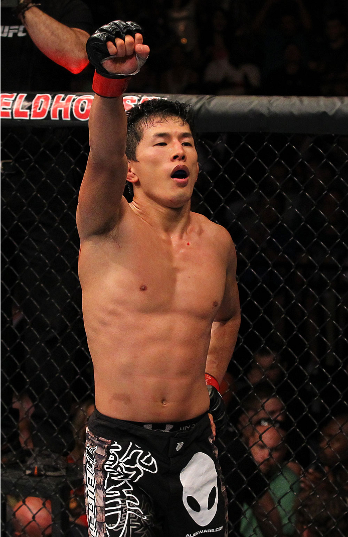 INDIANAPOLIS, IN - AUGUST 28:  Takeya Mizugaki reacts after his bantamweight fight against Erik Perez during the UFC on FOX Sports 1 event at Bankers Life Fieldhouse on August 28, 2013 in Indianapolis, Indiana. (Photo by Ed Mulholland/Zuffa LLC/Zuffa LLC