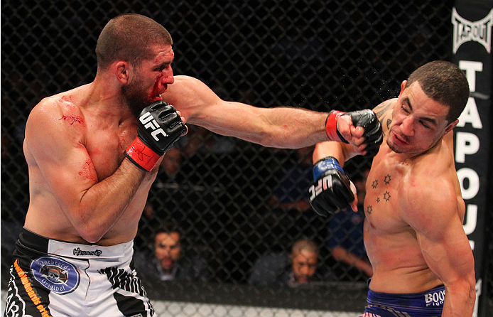 INDIANAPOLIS, IN - AUGUST 28:  (L-R) Court McGee punches Robert Whittaker in their welterweight fight during the UFC on FOX Sports 1 event at Bankers Life Fieldhouse on August 28, 2013 in Indianapolis, Indiana. (Photo by Ed Mulholland/Zuffa LLC/Zuffa LLC