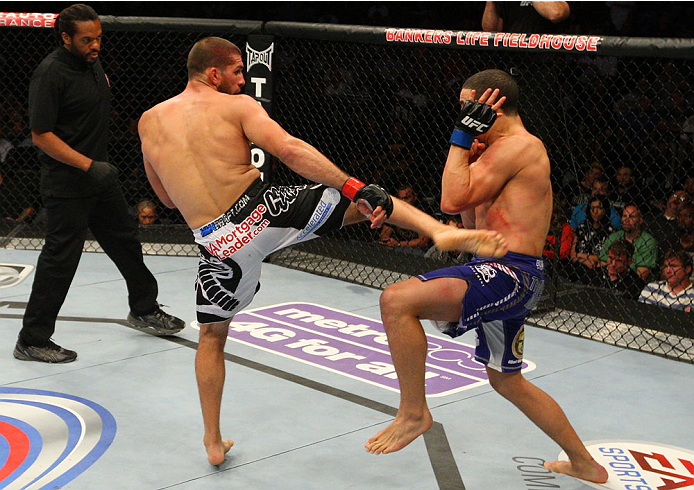 INDIANAPOLIS, IN - AUGUST 28:  (L-R) Court McGee kicks Robert Whittaker in their welterweight fight during the UFC on FOX Sports 1 event at Bankers Life Fieldhouse on August 28, 2013 in Indianapolis, Indiana. (Photo by Ed Mulholland/Zuffa LLC/Zuffa LLC vi