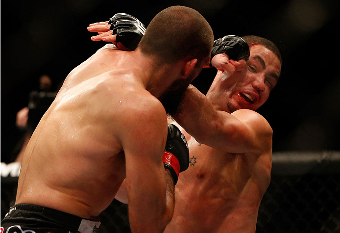 INDIANAPOLIS, IN - AUGUST 28:  (L-R) Court McGee punches Robert Whittaker in their welterweight fight during the UFC on FOX Sports 1 event at Bankers Life Fieldhouse on August 28, 2013 in Indianapolis, Indiana. (Photo by Josh Hedges/Zuffa LLC/Zuffa LLC vi