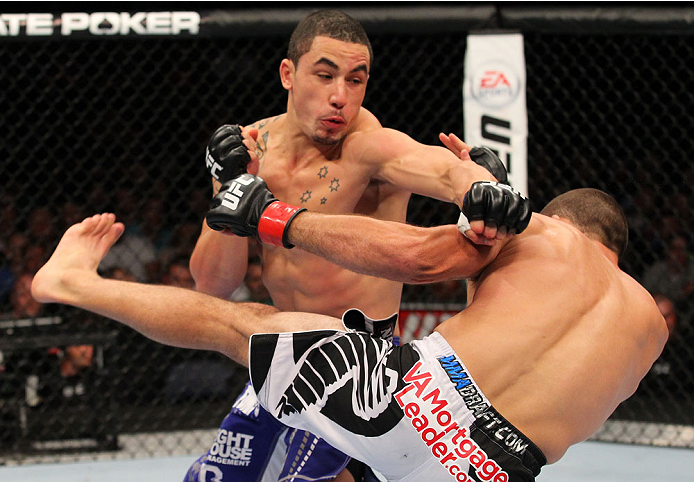INDIANAPOLIS, IN - AUGUST 28:  (L-R) Robert Whittaker punches Court McGee in their welterweight fight during the UFC on FOX Sports 1 event at Bankers Life Fieldhouse on August 28, 2013 in Indianapolis, Indiana. (Photo by Ed Mulholland/Zuffa LLC/Zuffa LLC
