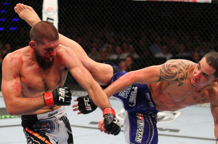 INDIANAPOLIS, IN - AUGUST 28:  (R-L) Robert Whittaker kicks Court McGee in their welterweight fight during the UFC on FOX Sports 1 event at Bankers Life Fieldhouse on August 28, 2013 in Indianapolis, Indiana. (Photo by Ed Mulholland/Zuffa LLC/Zuffa LLC vi