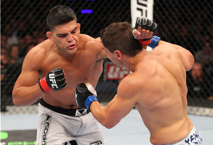INDIANAPOLIS, IN - AUGUST 28:  (L-R) Kelvin Gastelum punches Brian Melancon in their welterweight fight during the UFC on FOX Sports 1 event at Bankers Life Fieldhouse on August 28, 2013 in Indianapolis, Indiana. (Photo by Ed Mulholland/Zuffa LLC/Zuffa LL