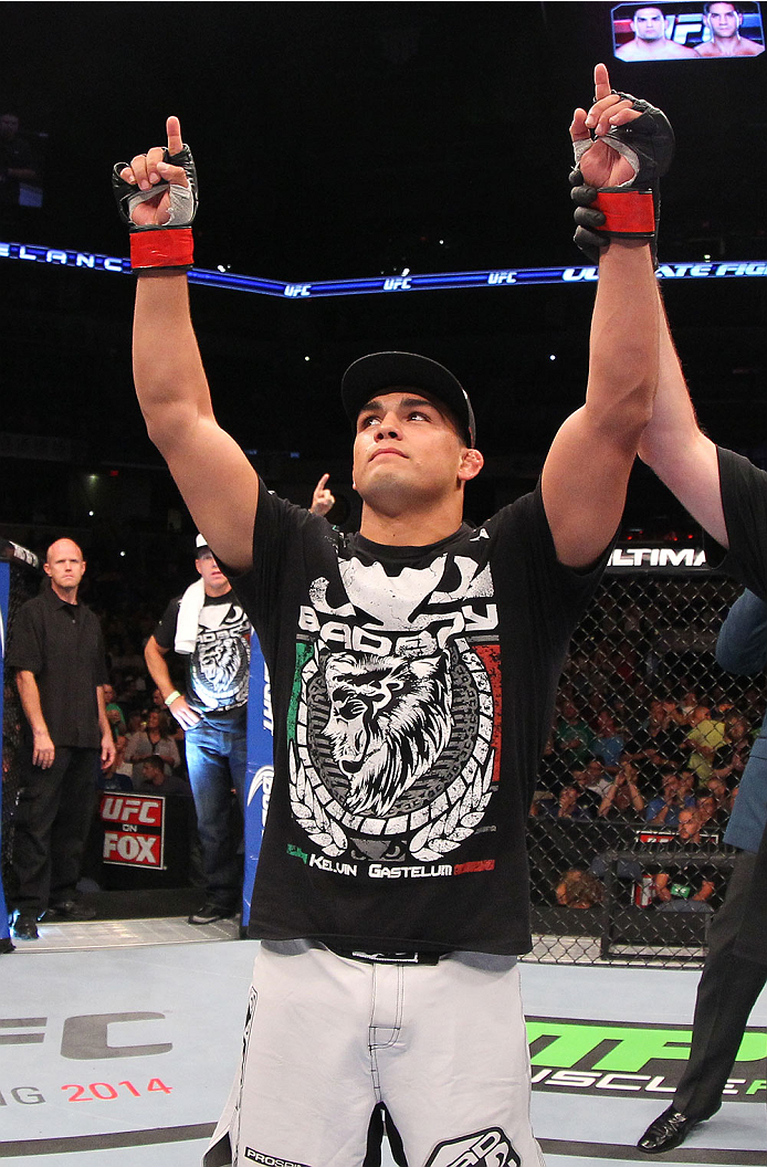 INDIANAPOLIS, IN - AUGUST 28:  Kelvin Gastelum reacts after his submission victory over Brian Melancon in their welterweight fight during the UFC on FOX Sports 1 event at Bankers Life Fieldhouse on August 28, 2013 in Indianapolis, Indiana. (Photo by Ed Mu