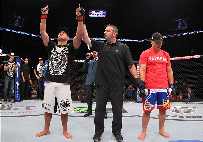 INDIANAPOLIS, IN - AUGUST 28:  Kelvin Gastelum (L) reacts after his submission victory over Brian Melancon in their welterweight fight during the UFC on FOX Sports 1 event at Bankers Life Fieldhouse on August 28, 2013 in Indianapolis, Indiana. (Photo by E