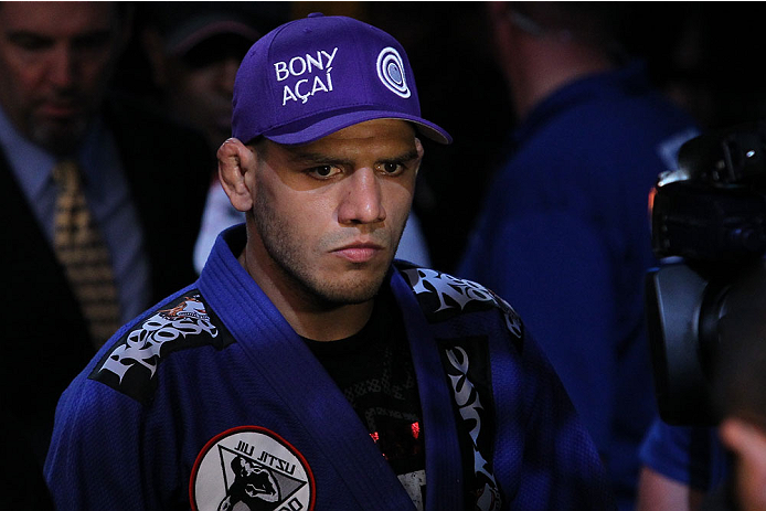"""INDIANAPOLIS, IN - AUGUST 28:  Rafael dos Anjos enters the arena before his lightweight fight against Donald """"Cowboy"""" Cerrone during the UFC on FOX Sports 1 event at Bankers Life Fieldhouse on August 28, 2013 in Indianapolis, Indiana. (Photo by Ed Mulholl"""