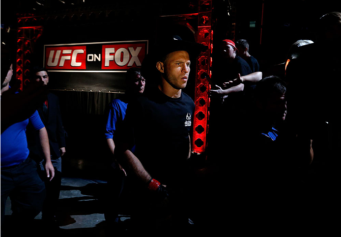 """INDIANAPOLIS, IN - AUGUST 28:  Donald """"Cowboy"""" Cerrone enters the arena before his lightweight fight against Rafael dos Anjos during the UFC on FOX Sports 1 event at Bankers Life Fieldhouse on August 28, 2013 in Indianapolis, Indiana. (Photo by Josh Hedge"""
