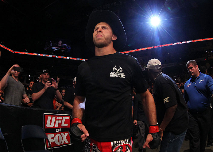 """INDIANAPOLIS, IN - AUGUST 28:  Donald """"Cowboy"""" Cerrone enters the arena before his lightweight fight against Rafael dos Anjos during the UFC on FOX Sports 1 event at Bankers Life Fieldhouse on August 28, 2013 in Indianapolis, Indiana. (Photo by Ed Mulholl"""