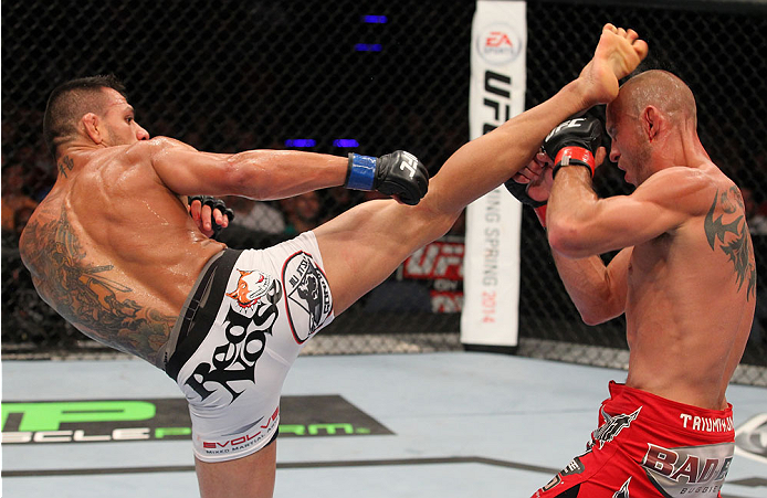 """INDIANAPOLIS, IN - AUGUST 28:  (L-R) Rafael dos Anjos punches Donald """"Cowboy"""" Cerrone in their lightweight fight during the UFC on FOX Sports 1 event at Bankers Life Fieldhouse on August 28, 2013 in Indianapolis, Indiana. (Photo by Ed Mulholland/Zuffa LLC"""