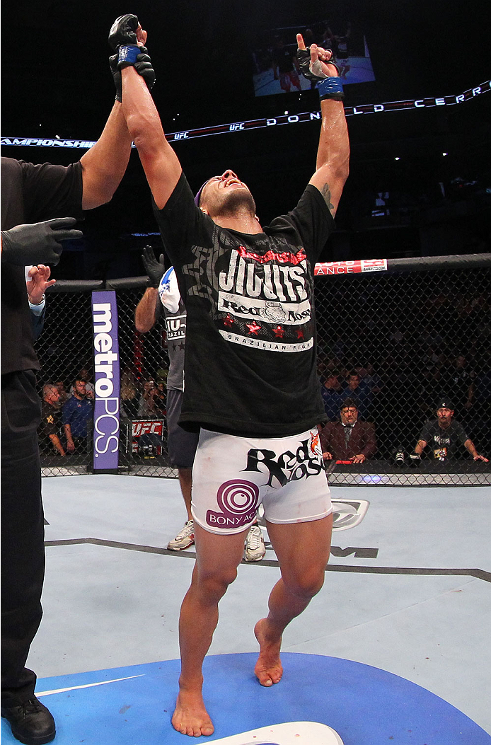 """INDIANAPOLIS, IN - AUGUST 28:  Rafael dos Anjos reacts after defeating Donald """"Cowboy"""" Cerrone in their lightweight fight during the UFC on FOX Sports 1 event at Bankers Life Fieldhouse on August 28, 2013 in Indianapolis, Indiana. (Photo by Ed Mulholland/"""