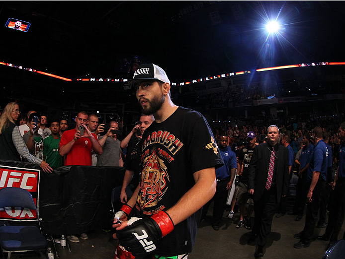 INDIANAPOLIS, IN - AUGUST 28:  Carlos Condit enters the arena before his welterweight fight against Martin Kampmann during the UFC on FOX Sports 1 event at Bankers Life Fieldhouse on August 28, 2013 in Indianapolis, Indiana. (Photo by Ed Mulholland/Zuffa