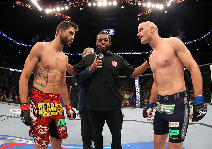 INDIANAPOLIS, IN - AUGUST 28:  (L-R) Opponents Carlos Condit and Martin Kampmann face off before their welterweight fight during the UFC on FOX Sports 1 event at Bankers Life Fieldhouse on August 28, 2013 in Indianapolis, Indiana. (Photo by Ed Mulholland/