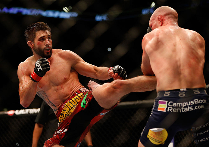 INDIANAPOLIS, IN - AUGUST 28:  (L-R) Carlos Condit punches Martin Kampmann in their welterweight fight during the UFC on FOX Sports 1 event at Bankers Life Fieldhouse on August 28, 2013 in Indianapolis, Indiana. (Photo by Josh Hedges/Zuffa LLC/Zuffa LLC v