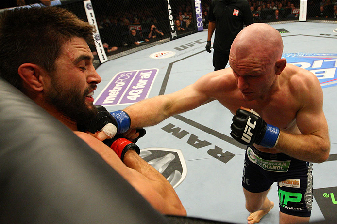 INDIANAPOLIS, IN - AUGUST 28:  (R-L) Martin Kampmann punches Carlos Condit in their welterweight fight during the UFC on FOX Sports 1 event at Bankers Life Fieldhouse on August 28, 2013 in Indianapolis, Indiana. (Photo by Ed Mulholland/Zuffa LLC/Zuffa LLC