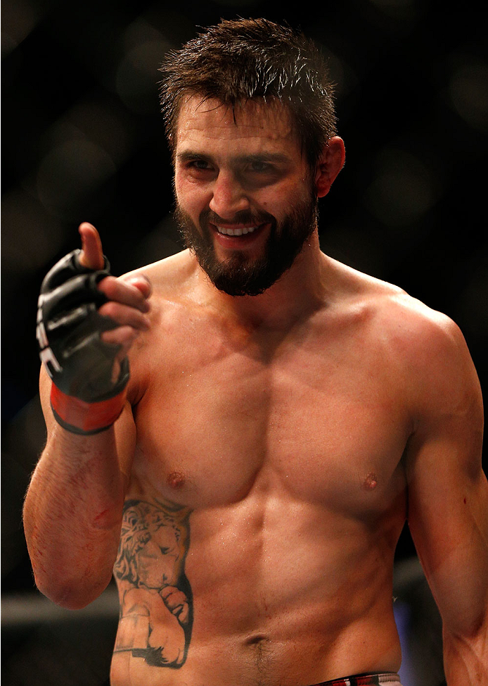 INDIANAPOLIS, IN - AUGUST 28:  Carlos Condit reacts after knocking out Martin Kampmann in their welterweight fight during the UFC on FOX Sports 1 event at Bankers Life Fieldhouse on August 28, 2013 in Indianapolis, Indiana. (Photo by Josh Hedges/Zuffa LLC