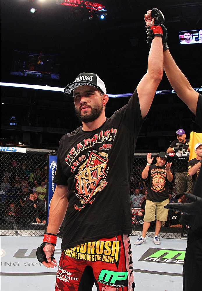 INDIANAPOLIS, IN - AUGUST 28:  Carlos Condit reacts after his TKO victory over Martin Kampmann in their welterweight fight during the UFC on FOX Sports 1 event at Bankers Life Fieldhouse on August 28, 2013 in Indianapolis, Indiana. (Photo by Ed Mulholland