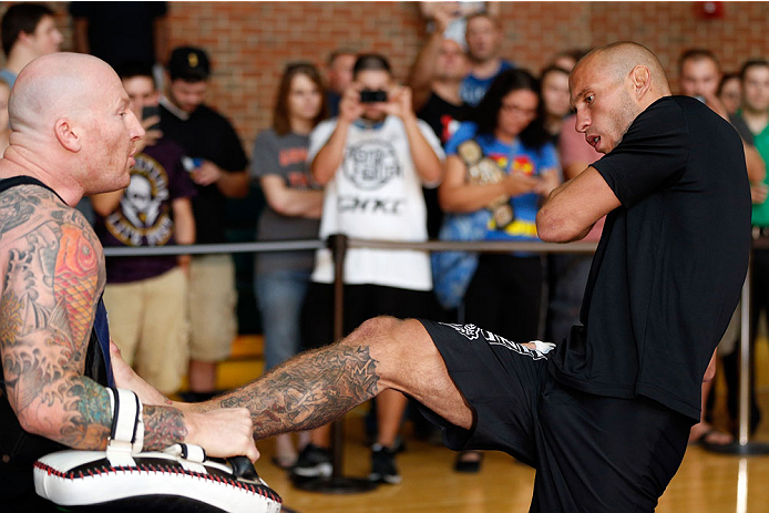 """INDIANAPOLIS, IN - AUGUST 26:  Donald """"Cowboy"""" Cerrone holds an open training session for fans and media at Banker's Life Fieldhouse on August 26, 2013 in Indianapolis, Indiana. (Photo by Josh Hedges/Zuffa LLC/Zuffa LLC via Getty Images)"""