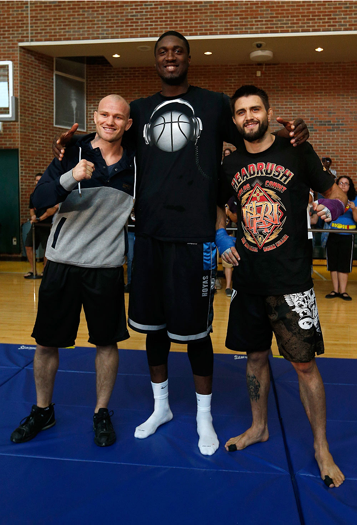 INDIANAPOLIS, IN - AUGUST 26:  Opponents Martin Kampmann (L) and Carlos Condit (R) pose for photos with Indiana Pacers center Roy Hibbert at Banker's Life Fieldhouse on August 26, 2013 in Indianapolis, Indiana. (Photo by Josh Hedges/Zuffa LLC/Zuffa LLC vi