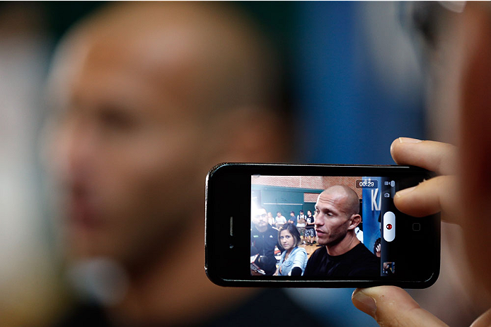 """INDIANAPOLIS, IN - AUGUST 26: Donald """"Cowboy"""" Cerrone interacts with media at Banker's Life Fieldhouse on August 26, 2013 in Indianapolis, Indiana. (Photo by Josh Hedges/Zuffa LLC/Zuffa LLC via Getty Images)"""