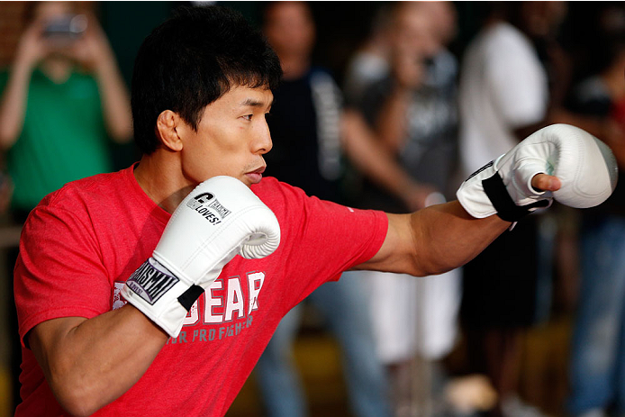 INDIANAPOLIS, IN - AUGUST 26:  Takeya Mizugaki holds an open training session for fans and media at Banker's Life Fieldhouse on August 26, 2013 in Indianapolis, Indiana. (Photo by Josh Hedges/Zuffa LLC/Zuffa LLC via Getty Images)