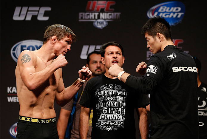 INDIANAPOLIS, IN - AUGUST 27:  (L-R) Opponents Darren Elkins and Hatsu Hioki face off during the UFC weigh-in event at Bankers Life Fieldhouse on August 27, 2013 in Indianapolis, Indiana. (Photo by Josh Hedges/Zuffa LLC/Zuffa LLC via Getty Images)