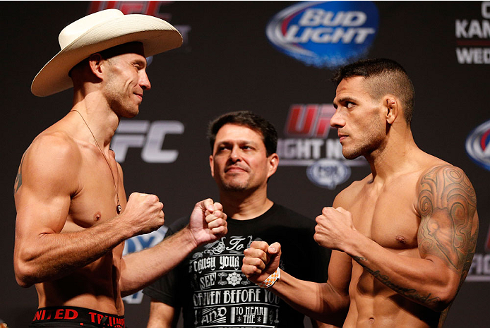 "INDIANAPOLIS, IN - AUGUST 27:  (L-R) Opponents Donald ""Cowboy"" Cerrone and Rafael dos Anjos face off during the UFC weigh-in event at Bankers Life Fieldhouse on August 27, 2013 in Indianapolis, Indiana. (Photo by Josh Hedges/Zuffa LLC/Zuffa LLC via Getty"