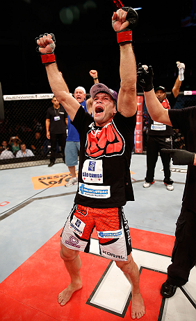 FORTALEZA, BRAZIL - JUNE 08:  Rodrigo Damm reacts after his split decision victory over Mizuto Hirota in their featherweight fight during the UFC on FUEL TV event at Paulo Sarasate Arena on June 8, 2013 in Fortaleza, Ceara, Brazil.  (Photo by Josh Hedges/