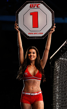 FORTALEZA, BRAZIL - JUNE 08:  UFC Octagon Girl Camila Rodrigues de Oliveira introduces a round during the UFC on FUEL TV event at Paulo Sarasate Arena on June 8, 2013 in Fortaleza, Ceara, Brazil.  (Photo by Josh Hedges/Zuffa LLC/Zuffa LLC via Getty Images
