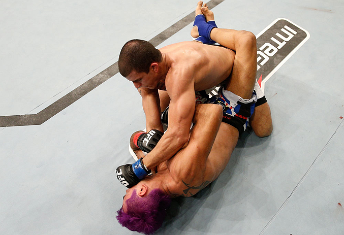 "FORTALEZA, BRAZIL - JUNE 08:  Felipe Arantes (top) punches Godofredo ""Pepey"" Castro in their featherweight fight during the UFC on FUEL TV event at Paulo Sarasate Arena on June 8, 2013 in Fortaleza, Ceara, Brazil.  (Photo by Josh Hedges/Zuffa LLC/Zuffa LL"
