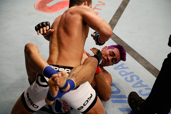 "FORTALEZA, BRAZIL - JUNE 08:  Felipe Arantes (top) elbows Godofredo ""Pepey"" Castro in their featherweight fight during the UFC on FUEL TV event at Paulo Sarasate Arena on June 8, 2013 in Fortaleza, Ceara, Brazil.  (Photo by Josh Hedges/Zuffa LLC/Zuffa LLC"