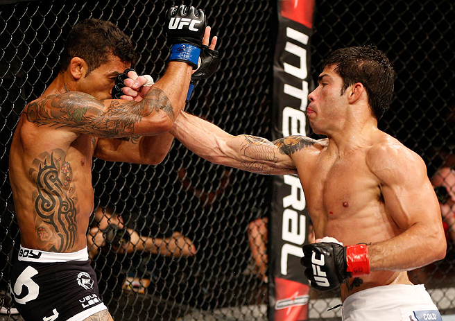 FORTALEZA, BRAZIL - JUNE 08:  (R-L) Raphael Assuncao punches Vaughan Lee in their bantamweight fight during the UFC on FUEL TV event at Paulo Sarasate Arena on June 8, 2013 in Fortaleza, Ceara, Brazil.  (Photo by Josh Hedges/Zuffa LLC/Zuffa LLC via Getty