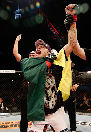 "FORTALEZA, BRAZIL - JUNE 08:  Rony ""Jason"" Mariano Bezerra reacts after defeating Mike Wilkinson in their featherweight fight during the UFC on FUEL TV event at Paulo Sarasate Arena on June 8, 2013 in Fortaleza, Ceara, Brazil.  (Photo by Josh Hedges/Zuffa"