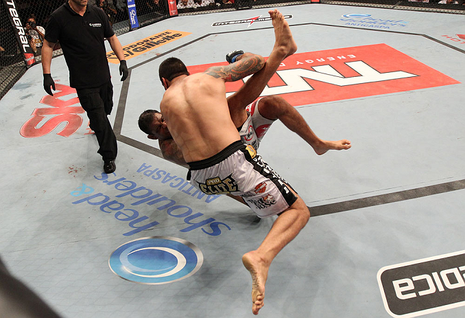 "FORTALEZA, BRAZIL - JUNE 08:  (L-R) Fabricio Werdum takes down Antonio Rodrigo ""Minotauro"" Nogueira in their heavyweight fight during the UFC on FUEL TV event at Paulo Sarasate Arena on June 8, 2013 in Fortaleza, Ceara, Brazil.  (Photo by Josh Hedges/Zuff"