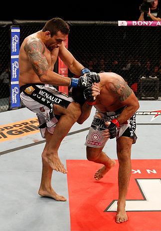 "FORTALEZA, BRAZIL - JUNE 08:  (L-R) Fabricio Werdum knees Antonio Rodrigo ""Minotauro"" Nogueira in their heavyweight fight during the UFC on FUEL TV event at Paulo Sarasate Arena on June 8, 2013 in Fortaleza, Ceara, Brazil.  (Photo by Josh Hedges/Zuffa LLC"
