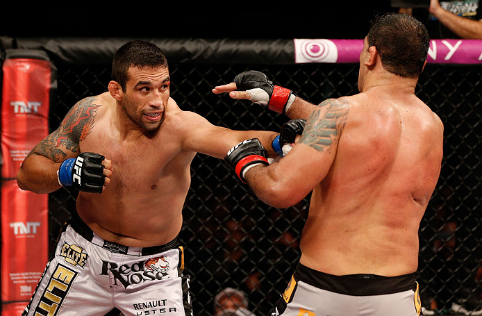 "FORTALEZA, BRAZIL - JUNE 08:  (L-R) Fabricio Werdum punches Antonio Rodrigo ""Minotauro"" Nogueira in their heavyweight fight during the UFC on FUEL TV event at Paulo Sarasate Arena on June 8, 2013 in Fortaleza, Ceara, Brazil.  (Photo by Josh Hedges/Zuffa L"