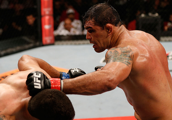 "FORTALEZA, BRAZIL - JUNE 08:  (R-L) Antonio Rodrigo ""Minotauro"" Nogueira punches Fabricio Werdum in their heavyweight fight during the UFC on FUEL TV event at Paulo Sarasate Arena on June 8, 2013 in Fortaleza, Ceara, Brazil.  (Photo by Josh Hedges/Zuffa L"