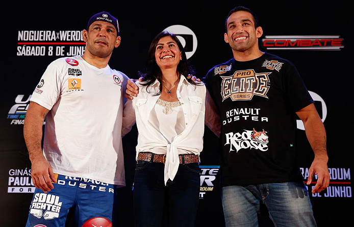 "FORTALEZA, BRAZIL - JUNE 06:  Opponents Antonio Rodrigo ""Minotauro"" Nogueira (L) and Fabricio Werdum pose for photos with UFC vice president Grace Tourinho at Centro de Eventos do Ceara on June 6, 2013 in Fortaleza, Ceara, Brazil.  (Photo by Josh Hedges/Z"