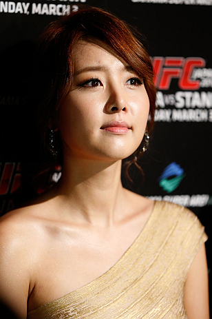 TOKYO, JAPAN - FEBRUARY 28: UFC Octagon Girl Su-Jung Lee is introduced to the media during the UFC open workouts at the Hilton Sjinjuku Hotel on February 28, 2013 in Tokyo, Japan. (Photo by Josh Hedges/Zuffa LLC/Zuffa LLC via Getty Images)