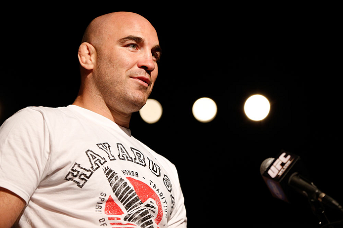 GOLD COAST, AUSTRALIA - DECEMBER 14:  Fellow UFC fighter Brian Ebersole asks a question of Dan Hardy during a Q&A session before the UFC on FX weigh in on December 14, 2012 at Gold Coast Convention and Exhibition Centre in Gold Coast, Queensland, Australi