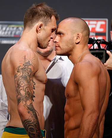 GOLD COAST, AUSTRALIA - DECEMBER 14:  (L-R) Opponents Benny Alloway and Manuel Rodriguez face off during the UFC on FX weigh in on December 14, 2012 at Gold Coast Convention and Exhibition Centre in Gold Coast, Queensland, Australia.  (Photo by Josh Hedge
