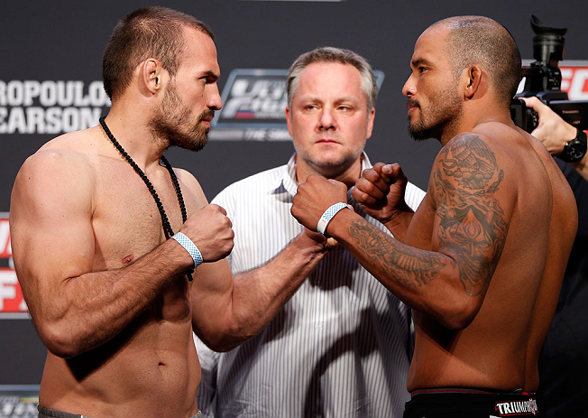 GOLD COAST, AUSTRALIA - DECEMBER 14:  (L-R) Opponents Igor Pokrajac and Joey Beltran face off during the UFC on FX weigh in on December 14, 2012 at Gold Coast Convention and Exhibition Centre in Gold Coast, Queensland, Australia.  (Photo by Josh Hedges/Zu