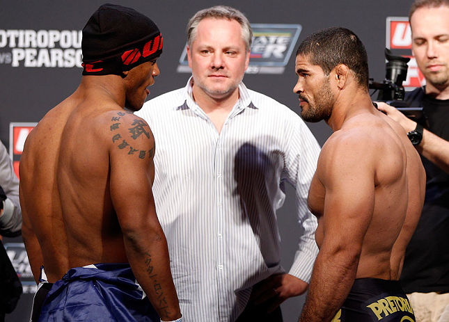 GOLD COAST, AUSTRALIA - DECEMBER 14:  (L-R) Opponents Hector Lombard and Rousimar Palhares face off during the UFC on FX weigh in on December 14, 2012 at Gold Coast Convention and Exhibition Centre in Gold Coast, Queensland, Australia.  (Photo by Josh Hed